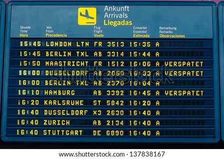 arrival information flight board at the airport - stock photo