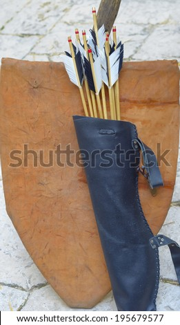 arrow bow quiver exhibition of medieval marketplace - stock photo