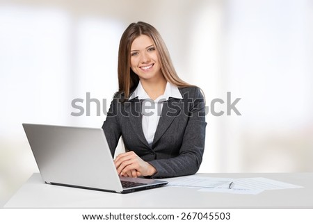 Arrow. Business woman sitting at white table with hand drawn graph charts - stock photo