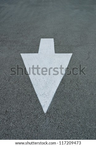Arrow direction sign, painted on asphalt, vector on the road. - stock photo