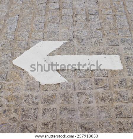 Arrow directional street sign - stock photo