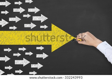 Arrow Leadership Concept on Blackboard - stock photo