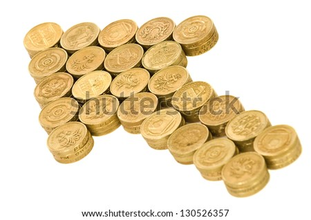 Arrow of British coins on white background - stock photo