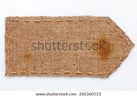 Arrow of burlap  lies on a white  background, can be used as texture - stock photo