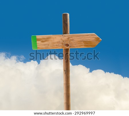 arrow on signpost indicating the correct path in blank with clouds and sky on background - stock photo