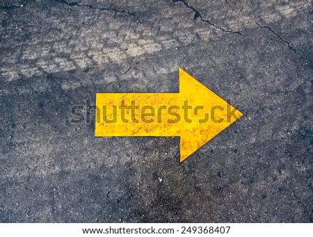 arrow on the asphalt road - stock photo
