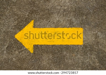 Arrow sign on the road  - stock photo