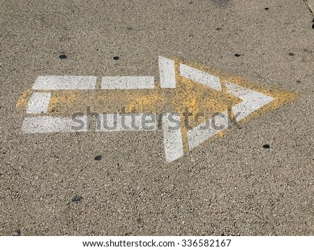 Arrow sign on the road to go right - stock photo