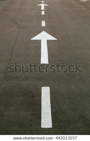 Arrow signs as road markings on a street. Toned image. - stock photo