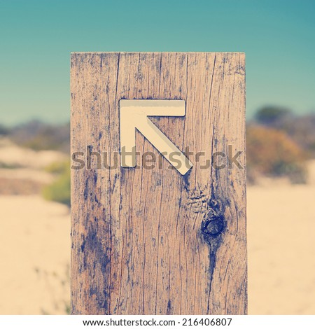 Arrow signs outside pointing the way on a walking trail with Instagram style filter - stock photo