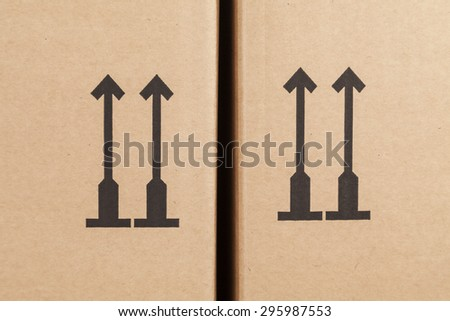 arrow symbol on a moving box - stock photo