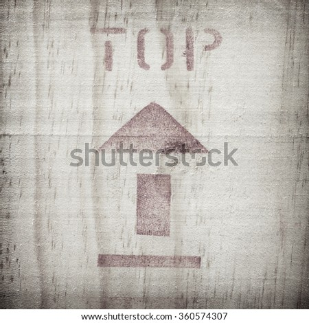 arrow up icon on wooden board - stock photo
