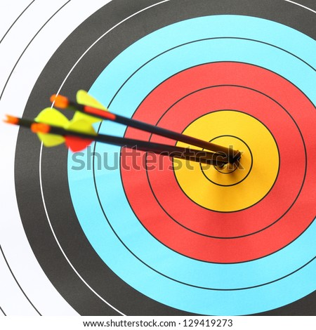 arrows focus to archery target - stock photo
