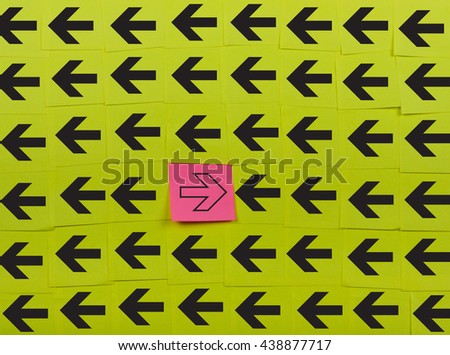 Arrows. Opposite concept. Background of green sticky notes.  - stock photo