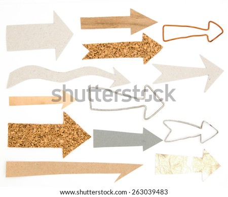 Arrows set with wood, cork, carton and metal. Didderent shapes of arrows isolated on a white background. Useful for infographics about ecology - stock photo