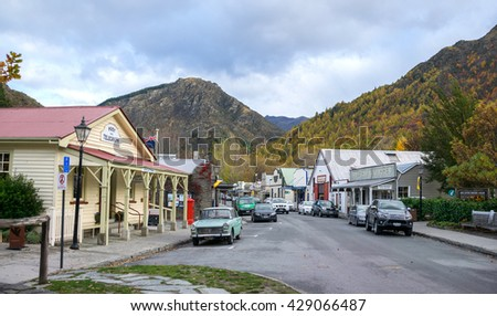 Arrowtown, New Zealand - 12 May, 2016: Arrowtown is a delightful gold rush village, charming and quirky and Buckingham Street of Arrowtown is a shopping experience.  - stock photo