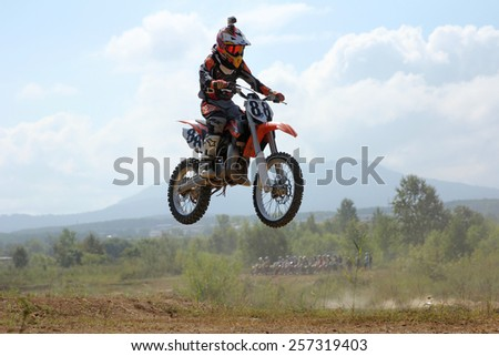 ARSENYEV, RUSSIA - AUG 30: Rider participates in the  round of the 2014 Russia motocross championship on August 30, 2014 in Arsenyev, Russia. - stock photo