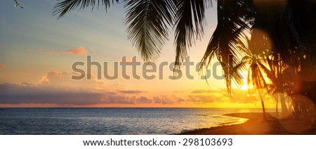 Art Beautiful sunrise over the tropical beach - stock photo