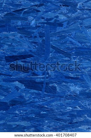 Art bright deep indigo tone color painted solid wafer flake repeat structure layer of old smartply aspenite bar fond design. Detail close-up macro view with space for text on hard composite mdf slab - stock photo