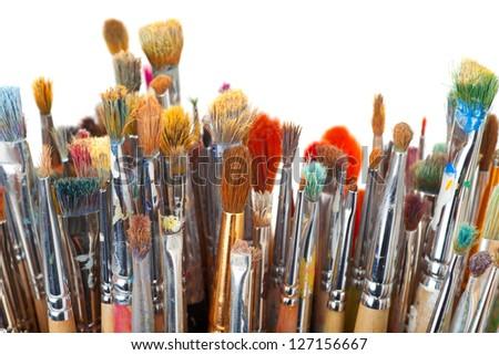 art brushes on white - stock photo