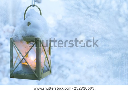 art Christmas lantern with snowfall - stock photo