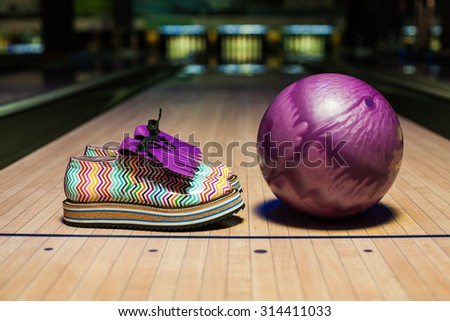 art craft pair of shoes at bowling track  - stock photo