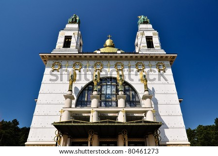 art deco church in vienna with golden cuppola in front of blue sky - stock photo