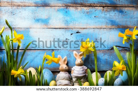 art Easter holidays background; family Easter bunny and Easter eggs - stock photo