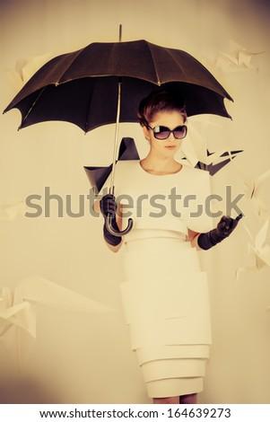 Art fashion photo of a gorgeous woman in paper dress. Sepia. - stock photo