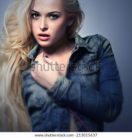 art fashion portrait of beautiful blond woman in jeans. denim blue jeans wear.Beauty Girl with Curly hair.Sexy woman.Long hair - stock photo