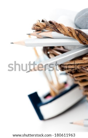 Art hobby set. Pencils in wicker basket with sea stones and toy boat - stock photo