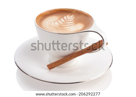 art latte on cappuccino coffee with cinnamon stick isolated on white. - stock photo