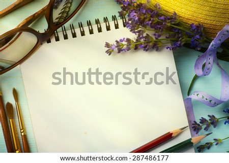 art morning in Provence; sketchbook and a bouquet of lavender  - stock photo