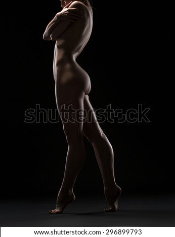 Art nude picture of naked blonde in the studio - stock photo