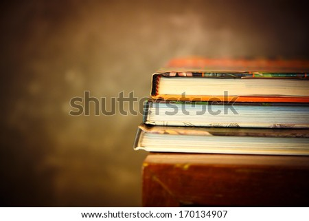 art of Old book stack on shelf - stock photo
