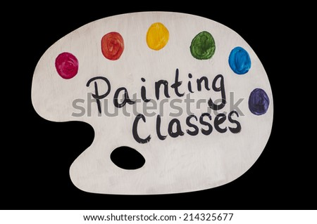 Art painting classes advertised on a colorful artist palette - stock photo