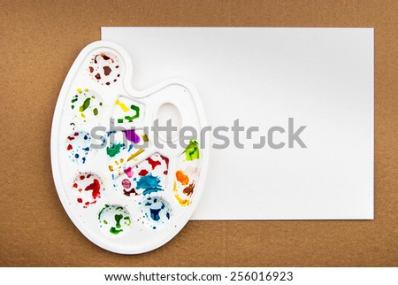 Art palette with blank paper for watercolor drawing - stock photo