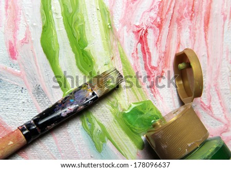 Art palette with lot of vivid colors and paintbrushes  - stock photo