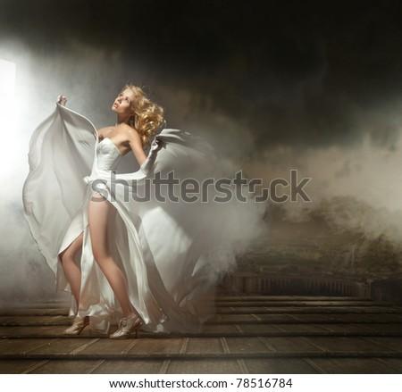 Art photo of a sexy woman in beautiful dress - stock photo