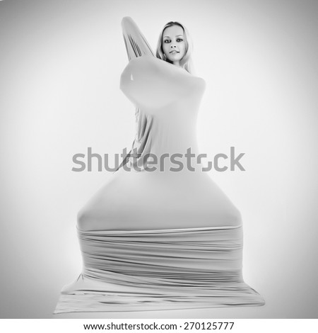 Art photo of a women silhouette breaking through the fabric.  Black and white photo - stock photo