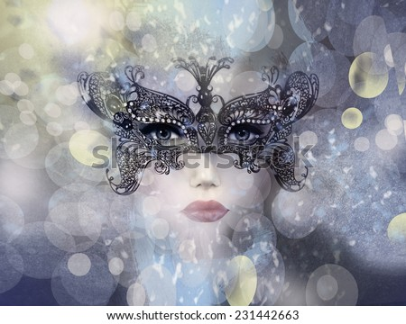 Art photo of Beautiful woman in mysterious mask. - stock photo