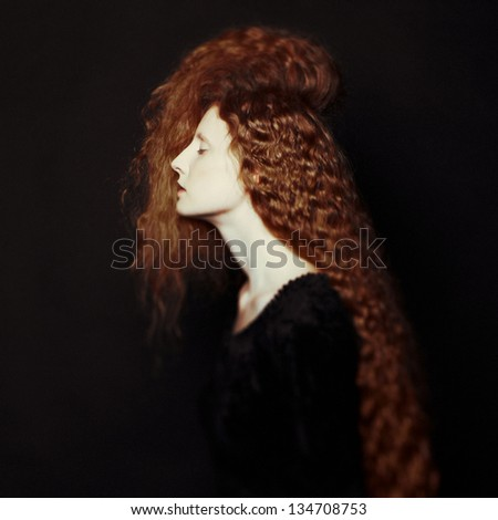 Art photo of young beautiful lady with magnificent bushy hair - stock photo