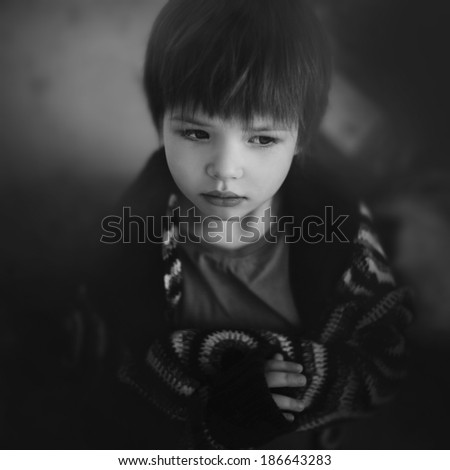 Art portrait of a beautiful child in a mysterious atmosphere - stock photo