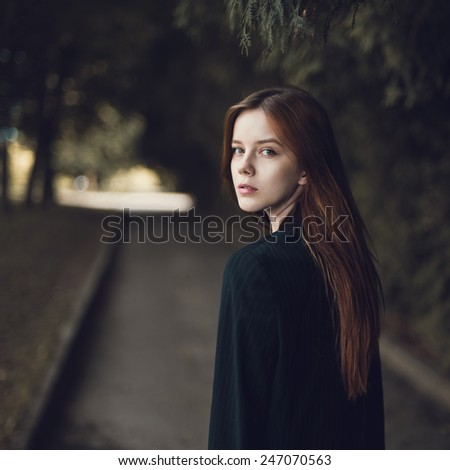 Art portrait of a beautiful girl in the park - stock photo