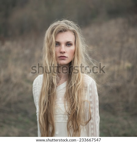 Art portrait of a beautiful lonely girl - stock photo
