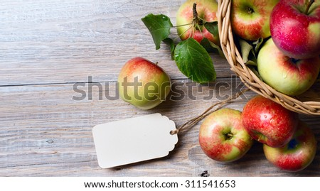 art Ripe red apples on wooden background - stock photo