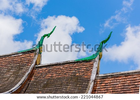 Art Roof of Wat Xieng Thong in Luang Prabang, Luang Prabang, Laos - stock photo