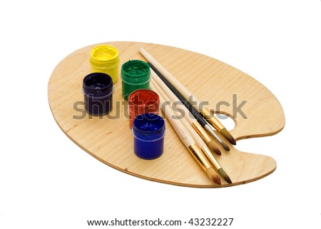 Art set: brushes and paint on palette, isolated - stock photo
