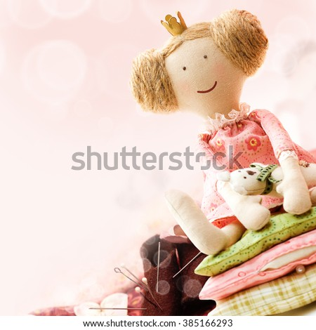 Art Sewing Accessory Background with Doll - stock photo