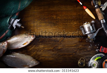 art sports fishing rod and tackle background - stock photo